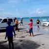 Jeep Liberty Attempts to Rescue Beached Camaro [VIDEO]