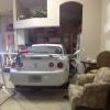 Car Smashes Through Glass Doors Into Florida Home…Again