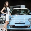 Why Do Women Models Pose Beside Cars at Auto Shows?