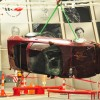 1993 Red 40th Anniversary Corvette in mid air over sinkhole Corvettes Being Pulled