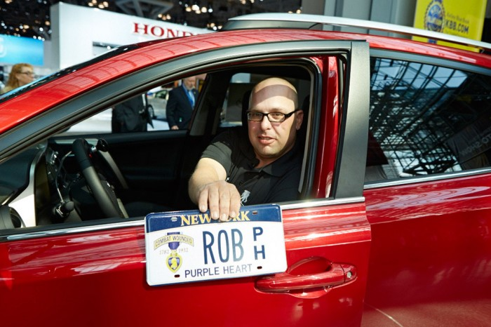 Robert Loria in his RAV4 with Rob Purple Heart license