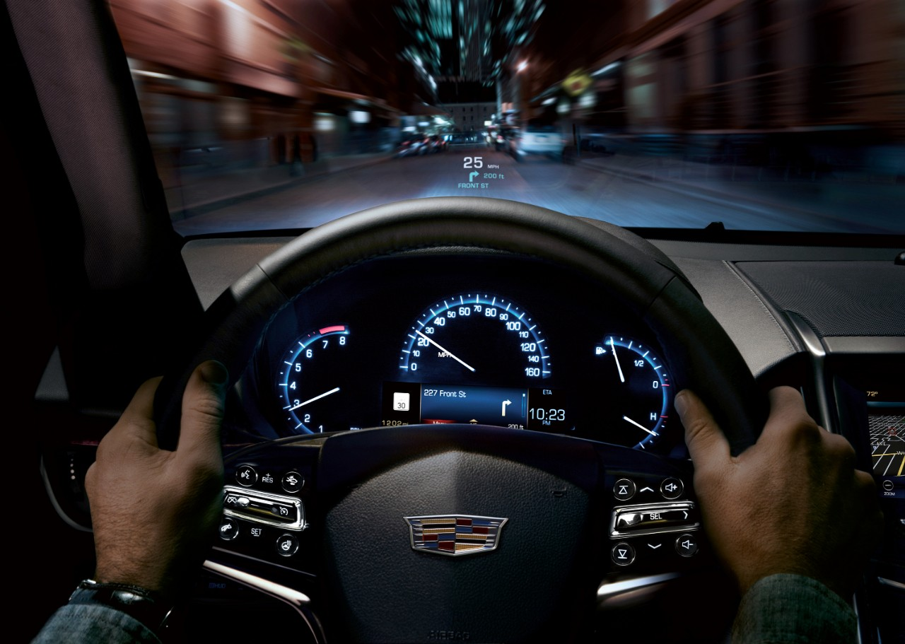 2015 cadillac ats interior steering wheel driving hands driver the news wheel. Black Bedroom Furniture Sets. Home Design Ideas