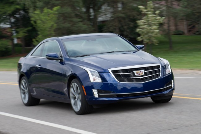 2015-Cadillac-ATScoupe-blue-front-driving-suburb-road