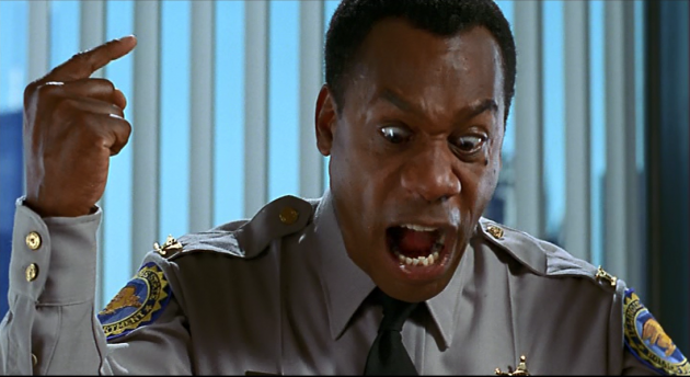 "Commander Cabel ""Cab"" Chamberlain (Joe Morton) does not take kindly to Elwood's  news that he is an illegitimate child"