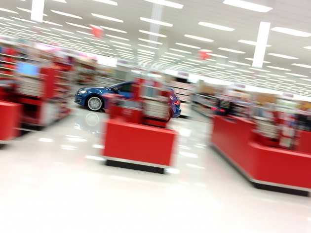 A 2015 VW Golf racing through Target (professional driver in closed Target, do not attempt)