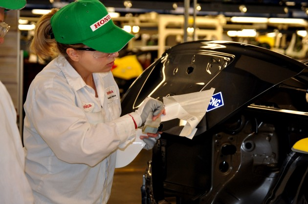 A worker assembles a Civic Natural Gas Vehicle at the Greensburg Honda Plant