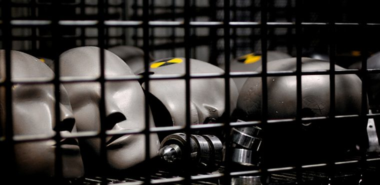 Fat Crash Test Dummies heads in cage Greg Westfall