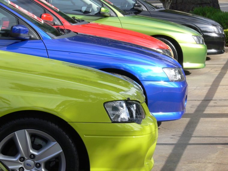 Used Car Prices Line of Colorful Car Lot Bumper