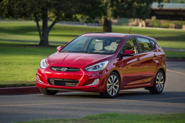 2015 Hyundai Accent Overview red exterior driving