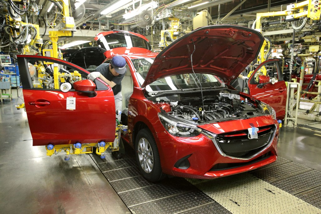 mazda2 thailand s first diesel car red exterior being