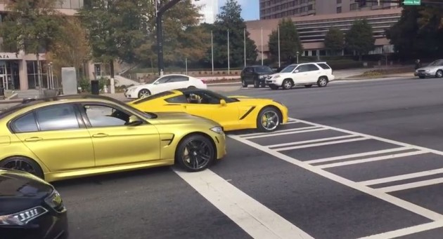 A BMW M3 and Corvette Stingray drag race in Atlanta, Georgia