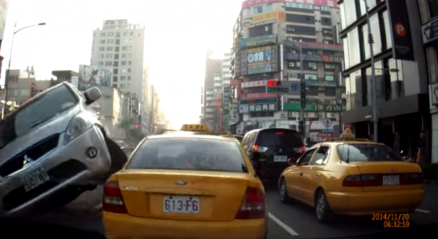 Mitsubishi Crashes Into Cab
