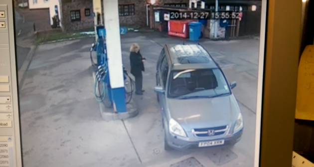 woman can't find gas cap
