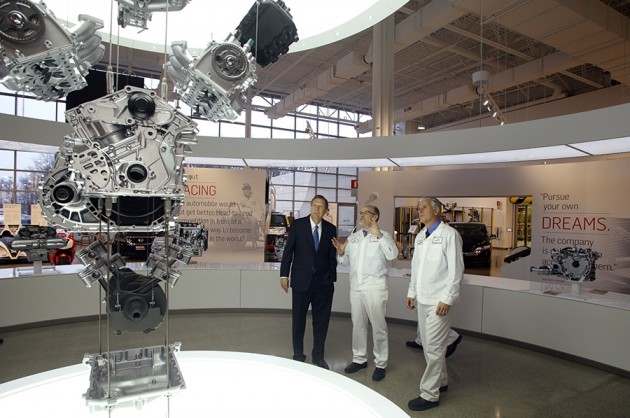From left to right, Ohio Governor John Kasich and Honda executives Tom Shoupe and Rick Schostek admire an Accord V6 engine and transmission at the new Honda museum in Ohio.