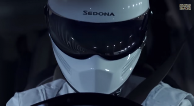 Here's how the driver in the Kia Sedona commercial originally looked