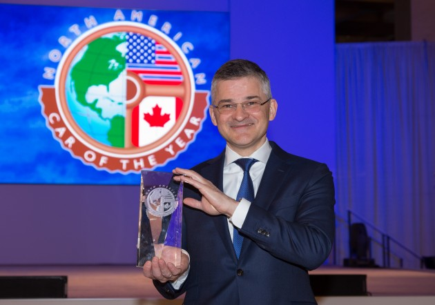 CEO Michael Horn with the 2015 North American Car of the Year Award for the VW Golf and Golf GTI