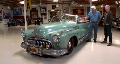 Jay Leno and Jonathan Ward examine a souped-up 1948 Buick Super Convertible