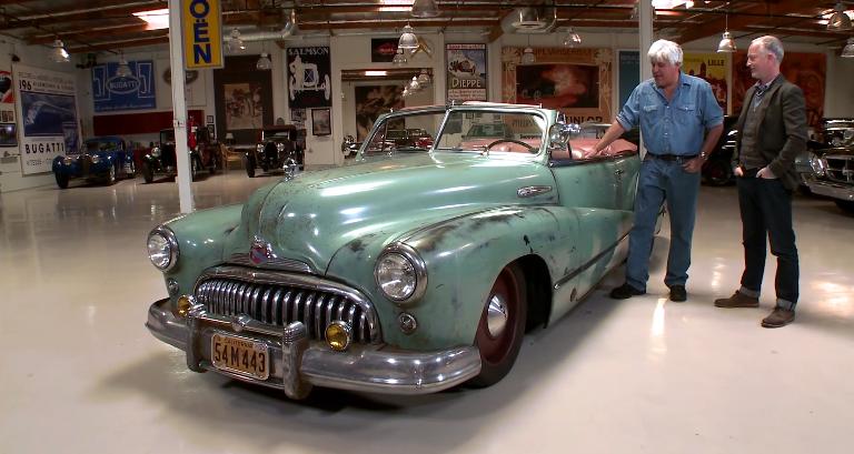 Jay Leno and Jonathan Ward examine a souped-up 1948 Buick Super Convertible
