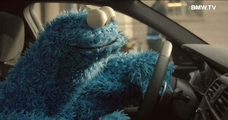 Cookie Monster Driving A Car