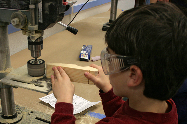 Pinewood Derby Cars building tips via Flickr sanding wood boy