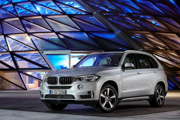 Silver plug-in BMW X5 xDrive40e SUV front at night