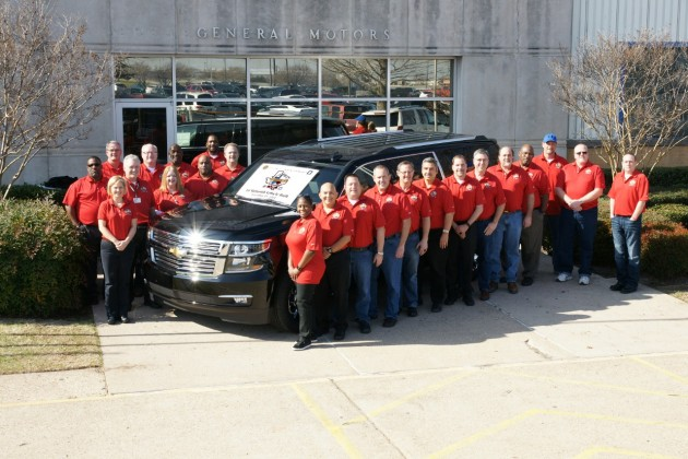 Employees at the GM Arlington Assembly Center gather around the plant's 10 millionth vehicle, a 2015 Chevy Suburban
