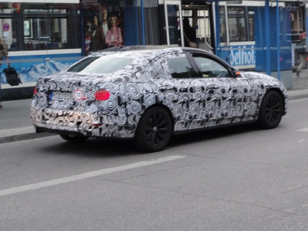 BMW prototype in black and white camouflage car wrap spy shot