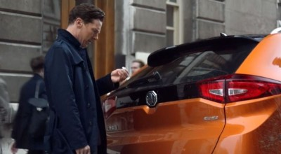 Benedict Cumberbatch as Sherlock Holmes persona in Chinese MG Cars ad inspecting orange MG GS