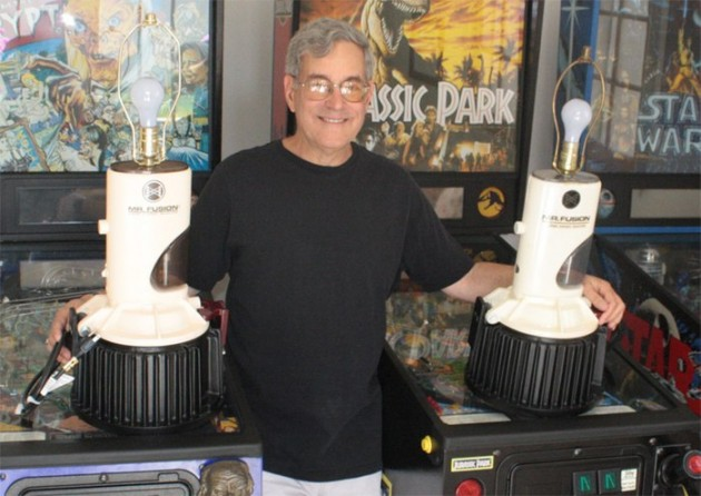 Bob Gale poses with two of the world's four Mr. Fusion lamps