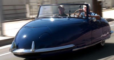 Jay Leno (right) and Peterson Museum curator Leslie Kendall take a '48 Davin out for a spin