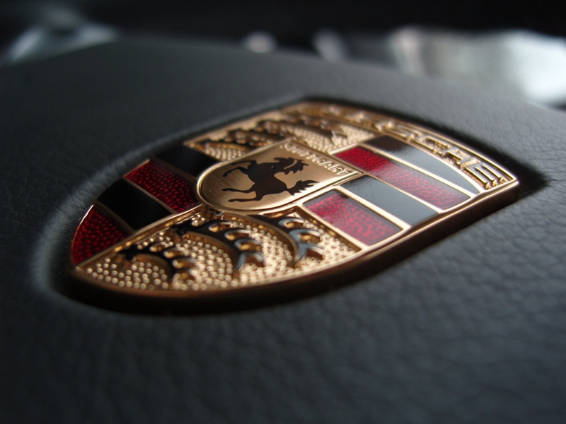 behind the badge revealing the historic porsche crest s inspiration