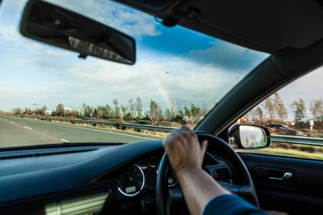 Why do UK motorists drive on the opposite side of the road?