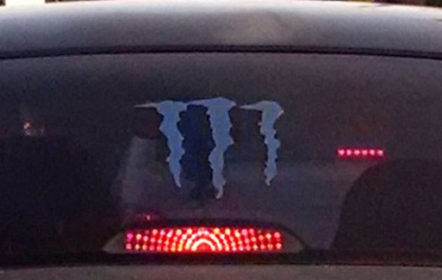 Florida Man Photographs Reptilian Alien Driving a Kia Spectra