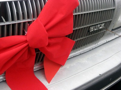Red bow on car