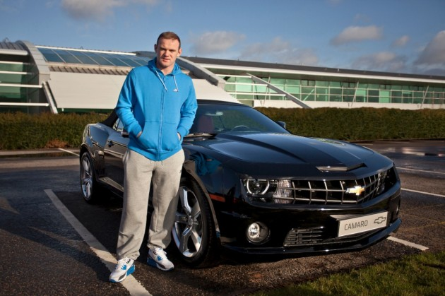 Manchester United player Wayne Rooney, looking positively thrilled with his new Camaro convertible