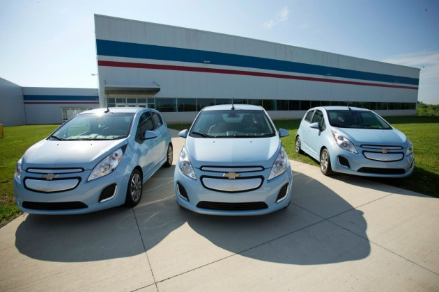 Three Chevy Spark EVs parked outside the Baltimore Complex