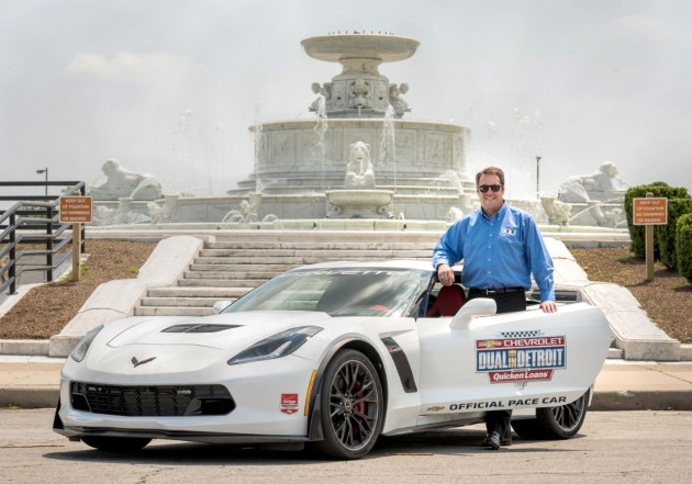 Chevrolet VP Mark Reuss poses with the Chevrolet Dual in Detroit pace car