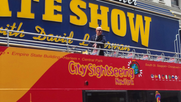 Paul Shaffer atop his dedicated Gray Line bus in front of the Ed Sullivan Theater