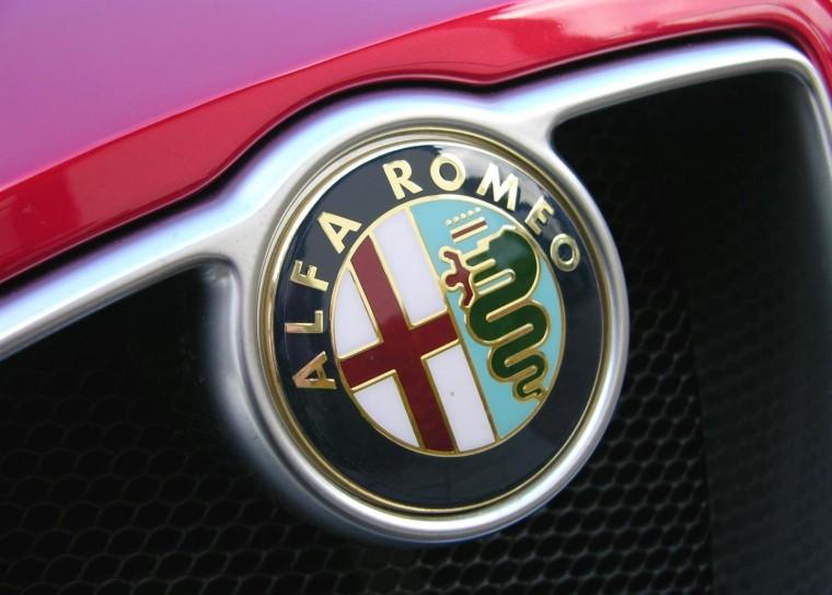 Behind Badge Why Alfa Romero Logo Features Snake Eating Guy emblem