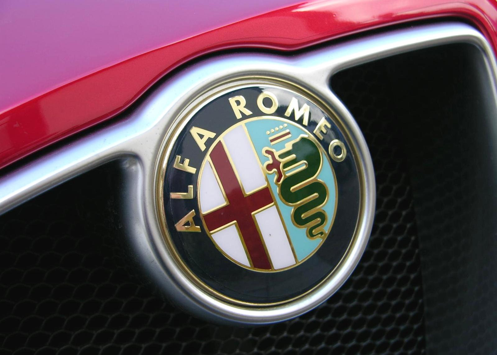 Behind The Badge Why Alfa Romeos Logo Features A Snake Eating A