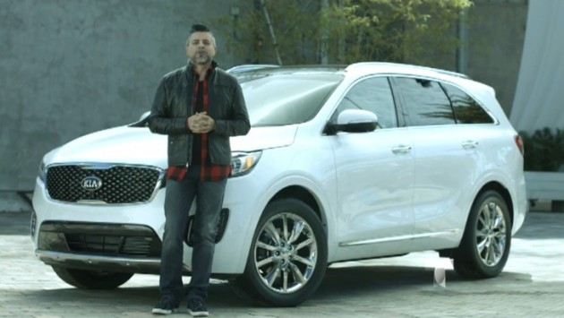 """El Maestro: Unplugged"" host Luis Enrique stands in front of a 2016 Kia Sorento"