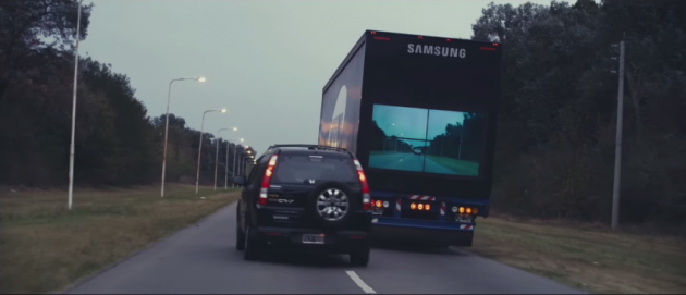 A Honda CR-V passes the high-tech Samsung Safety Truck on an Argentinian highway