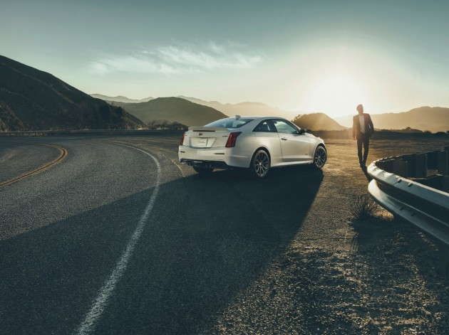 2016 Cadillac ATS-V parked in front of a sunset