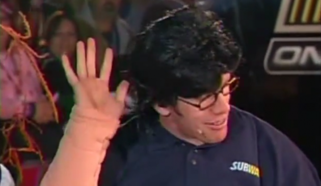 Edwards dons glasses, a wig, and a fat suit costume to play a pre-weight loss Jared Fogle
