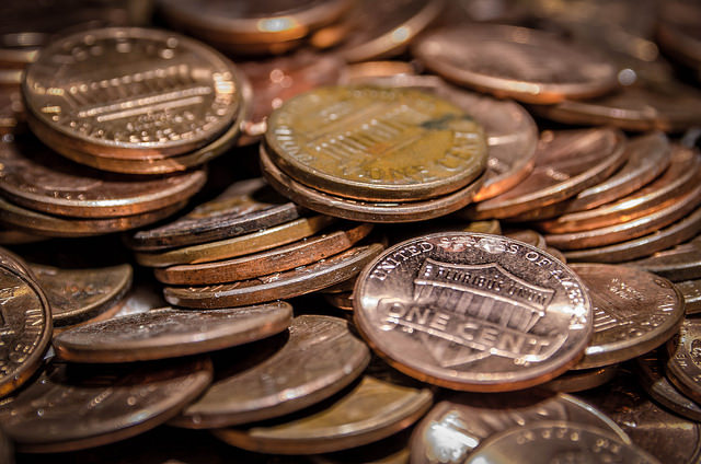 student pays parking fine with pennies