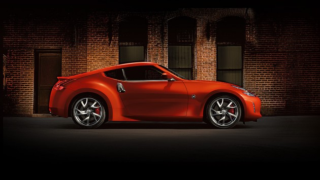 2016-nissan-370Z-coupe-magma-red-brick-wall-side-view-large
