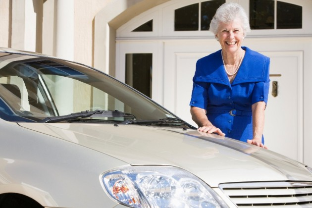 Senior Citizen standing by car old person woman