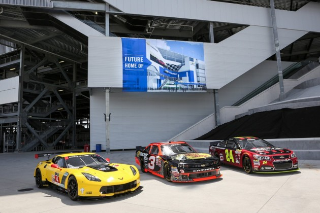 A Corvette C7.R, NASCAR Xfinity Series Chevrolet Camaro, and NASCAR Sprint Cup Chevrolet SS parked in front of the future home of Daytona's Chevrolet entrance