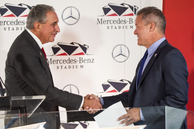 Owner of the Falcons and United, Arthur Bank, and Mercedes-Benz USA president and CEO, Stephen Cannon, shakes hands over deal for Mercedes-Benz Stadium