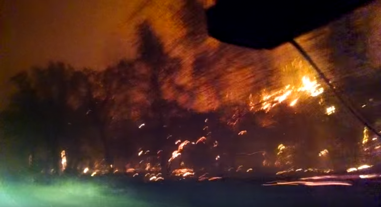 Northern California forest fire burning hillside